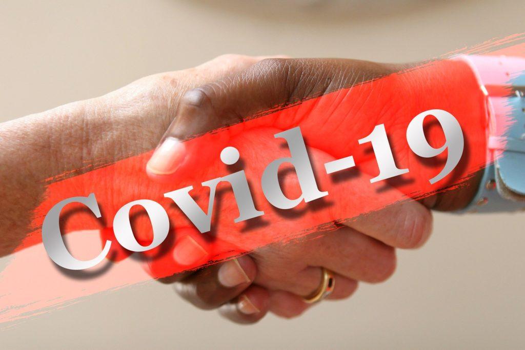 Una stretta di mano bloccata dal Covid - 19